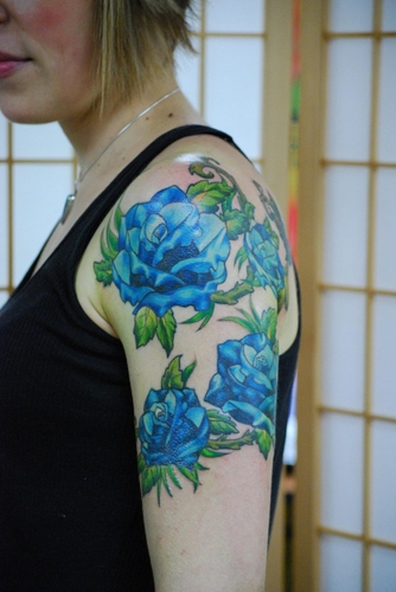 flower and vine tattoos. Blue Rose Vine Tattoo