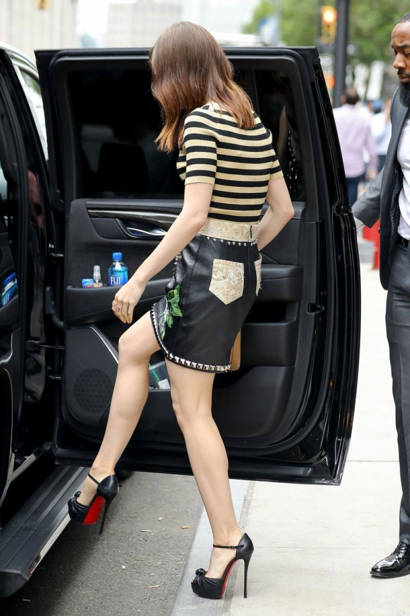 Lily Collins leggy in a high waisted leather short skirt with ankle strap platform Christian Louboutin high heels