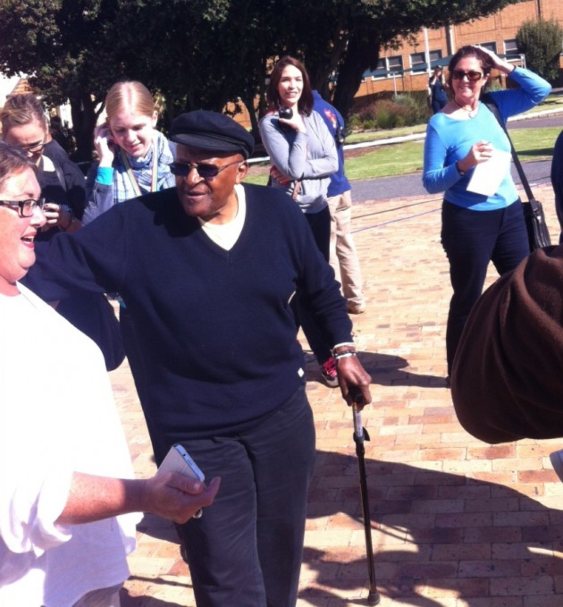 Anglican Archbishop Desmond Tutu and his wife Leah were ushered to the front of a long queue at the Milnerton High School today – but fellow voters in the seaside Cape Town suburb didn't seem to mind. Tutu (82) was barely recognisable without his pur