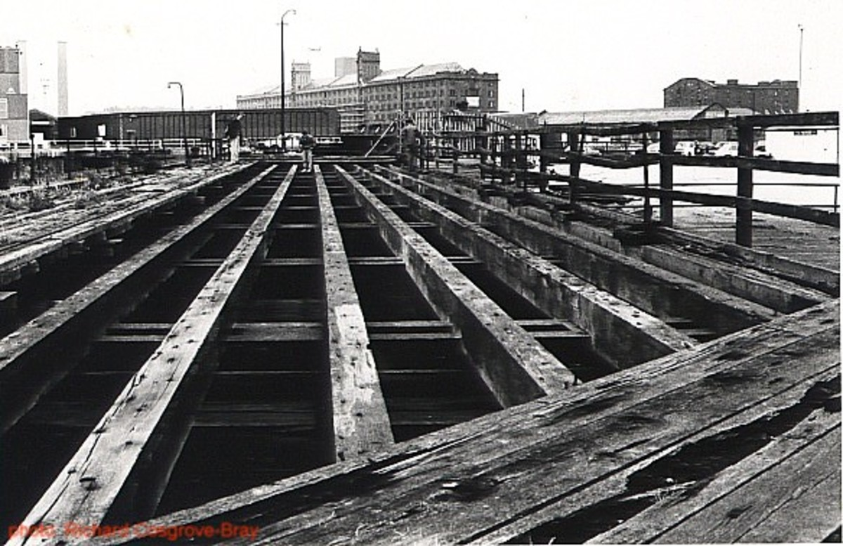 A structural dockside skeleton laid bare to the elements, now demolished.