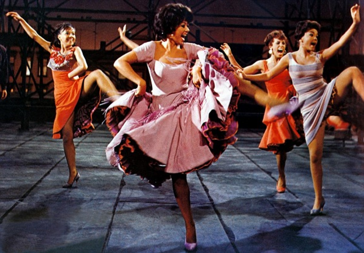 "Anita (played by Rita Moreno in the movie) in West Side Story, singing and dancing to ""America"""
