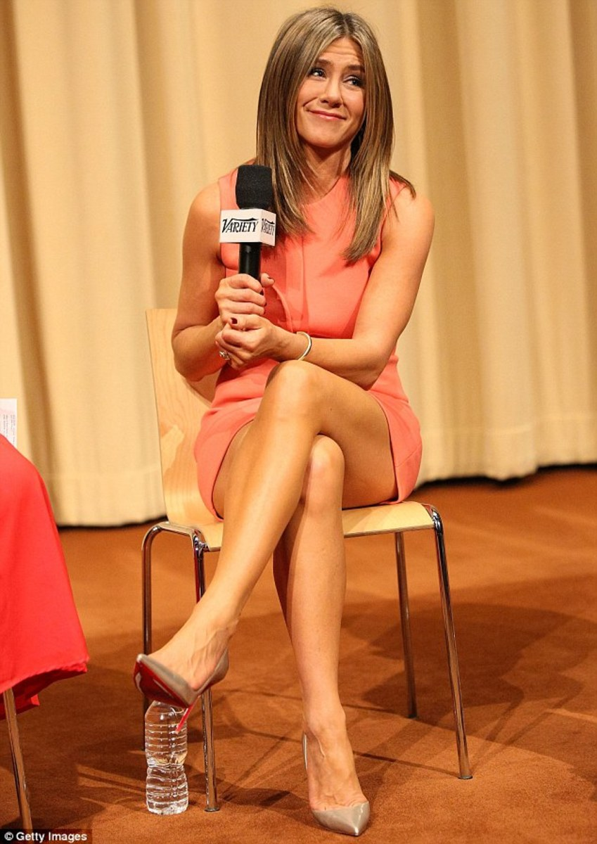 Jennifer Aniston in a peach dress and nude Louboutin pumps