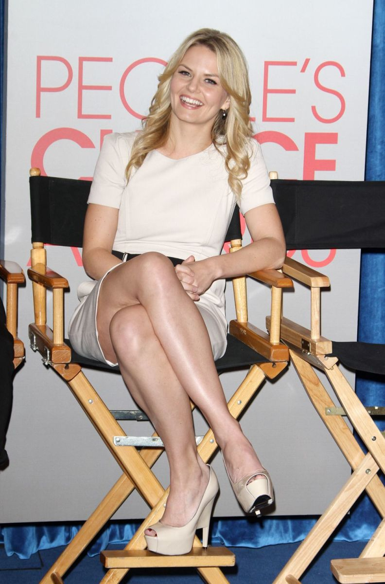 Jennifer Morrison toned legs crossed in a short skirt and pumps