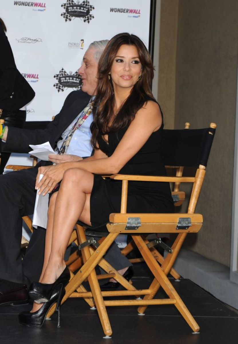 Eva Longoria Parker crosses her legs wearing towering high heel stilettos