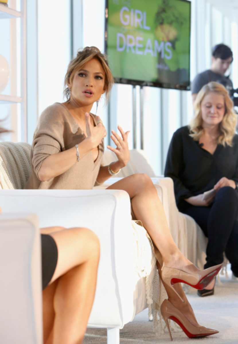 Jennifer Lopez talking fragrance wearing Christian Louboutin high heels