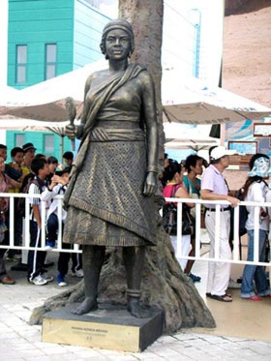 Queen Nzinga Mbandi`s sculpture outside the Angola Pavilion