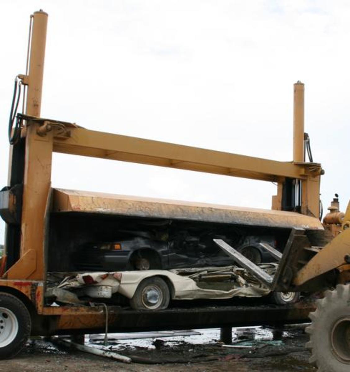 hydraulic press crushing cars