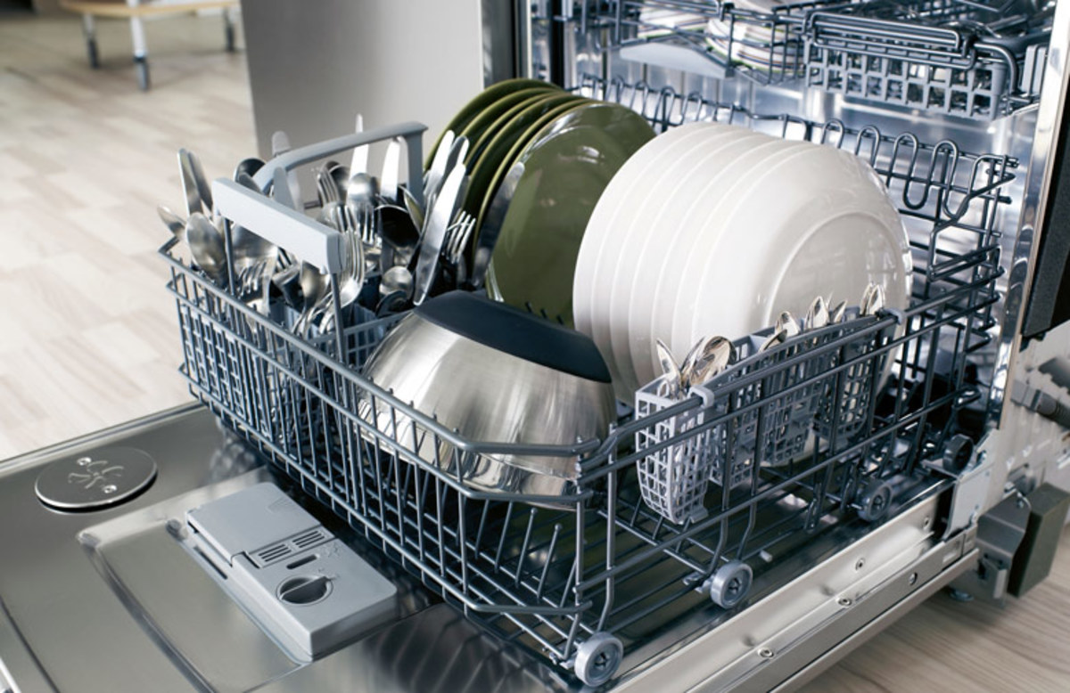 The interior of an extra large Asko Brand Dishwasher