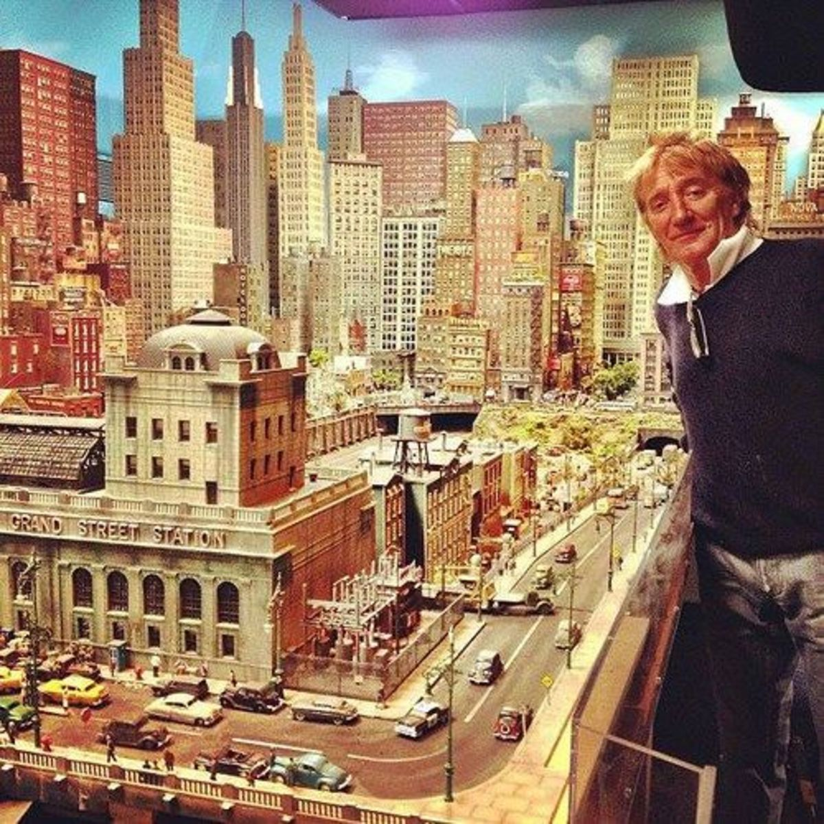 Rod Stewart posed in front of a portion of his model train set