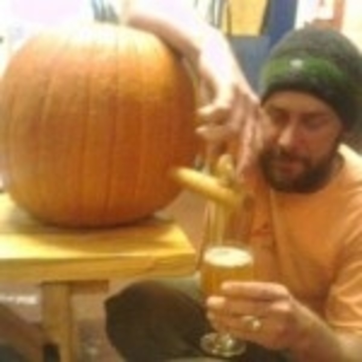 Jason McAdam drinking pumpkin beer from a pumpkin