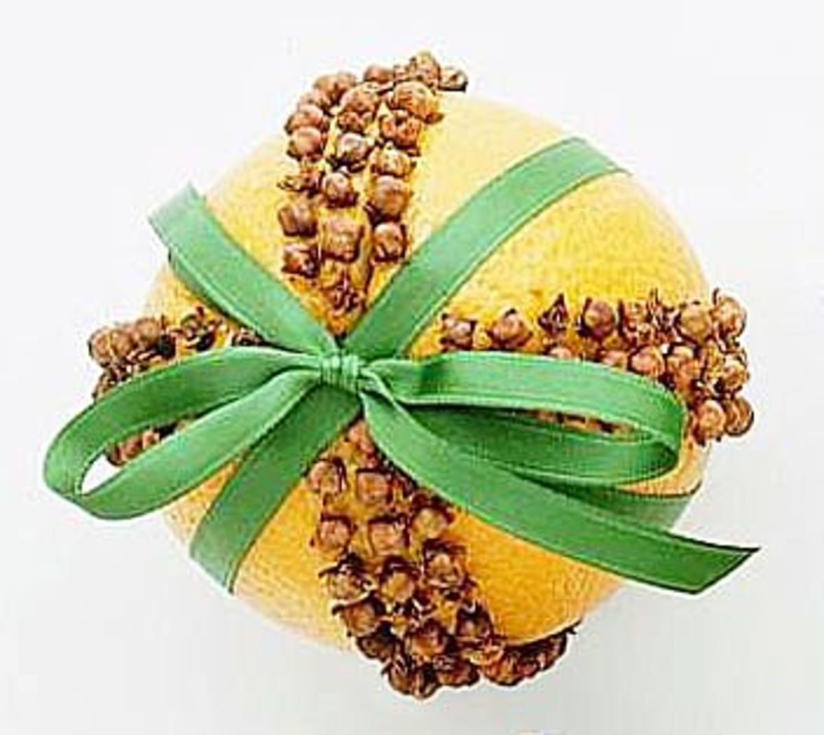 Orange pomander with green ribbon.