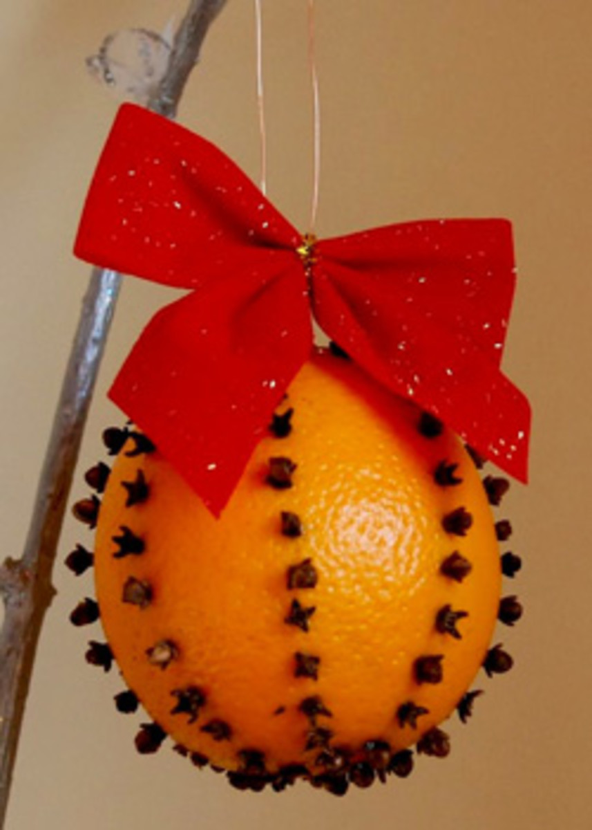 Orange pomander with red velvet ribbon.