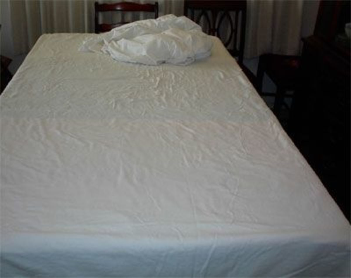 Next, arrange a large white cotton sheet over the towels. Do not use flannel. Smooth the sheet out as best you can. As you can see, I didn't iron it, but one could.