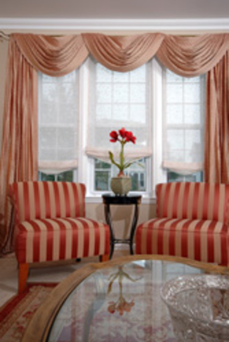 Living room with a bold design palette and soft drapes in a neutral tone.