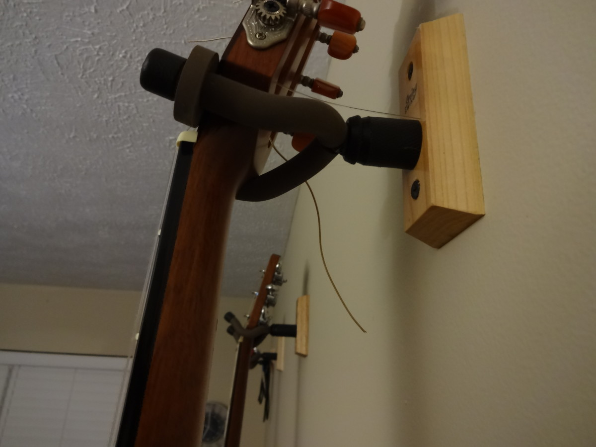 Hanging guitars may be better for the neck than sitting on a stand or laying in a case. Then there's the convenience.