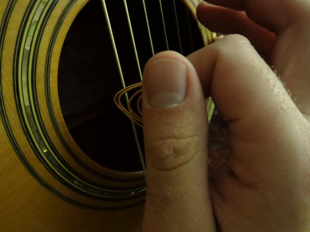 Strumming with a wire guitar pick will produce a very bright and loud sound. Be careful though. The wire may wear away your guitar strings' metal faster.