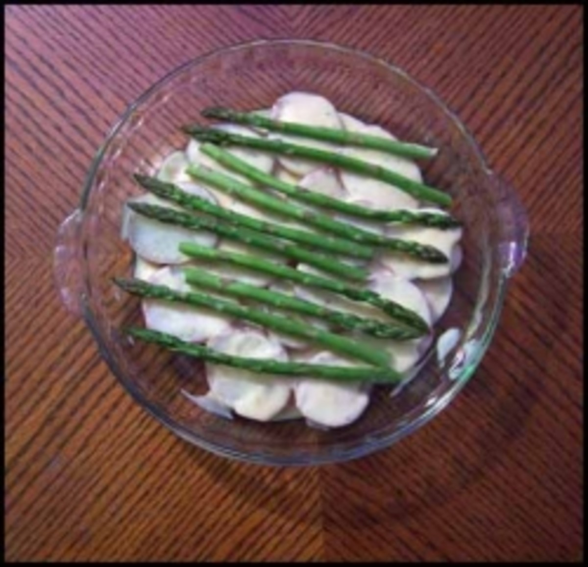 Tender asparagus atop the cheese sauce and potatoes