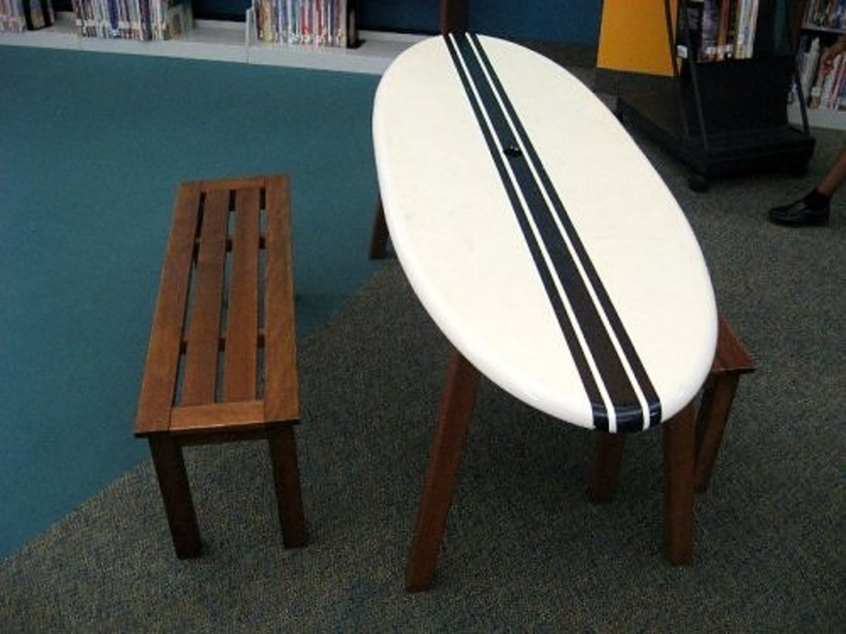 A flat surfboard with legs and a bench provides table space in the picture book area.