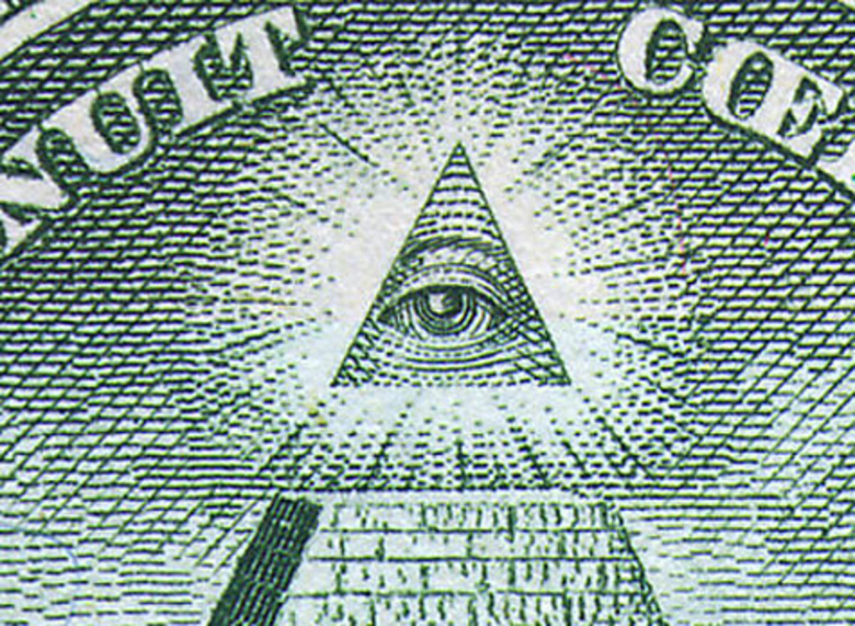 The 'eye of the illuminati' on top of a Masonic pyramid symbol on a dollar bill