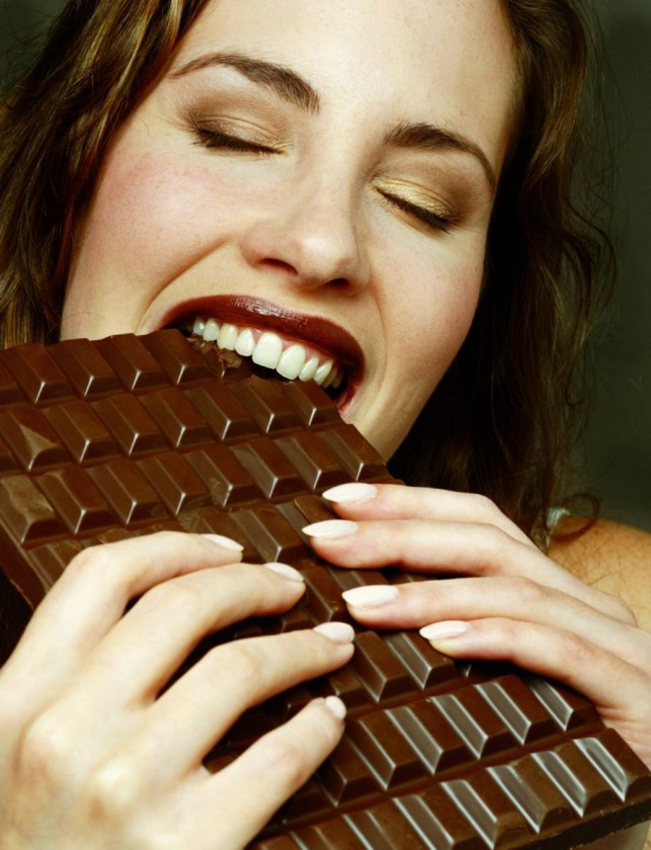 Woman Enjoying a Little Chocolate
