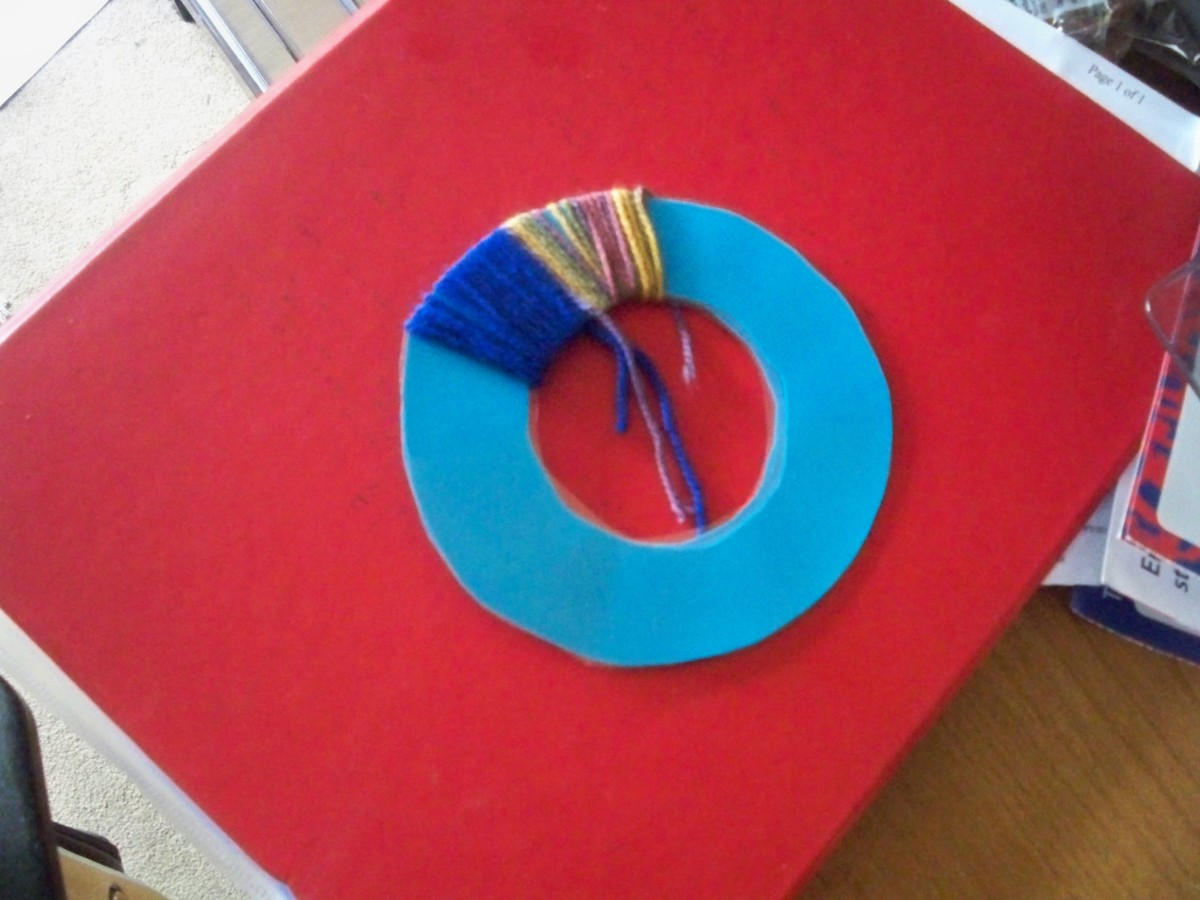If making with young children use a much bigger hole and no needle