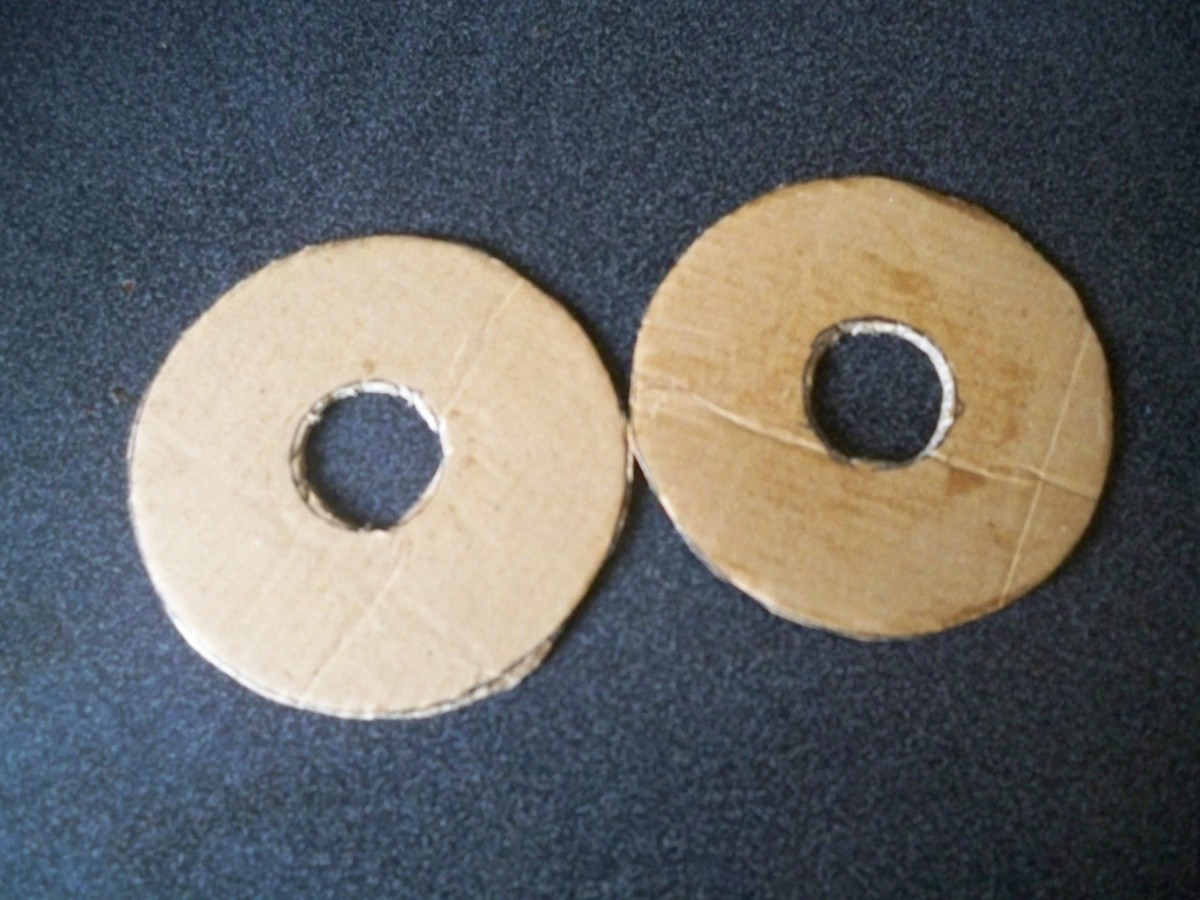 Cut two circles of card with an inner circle