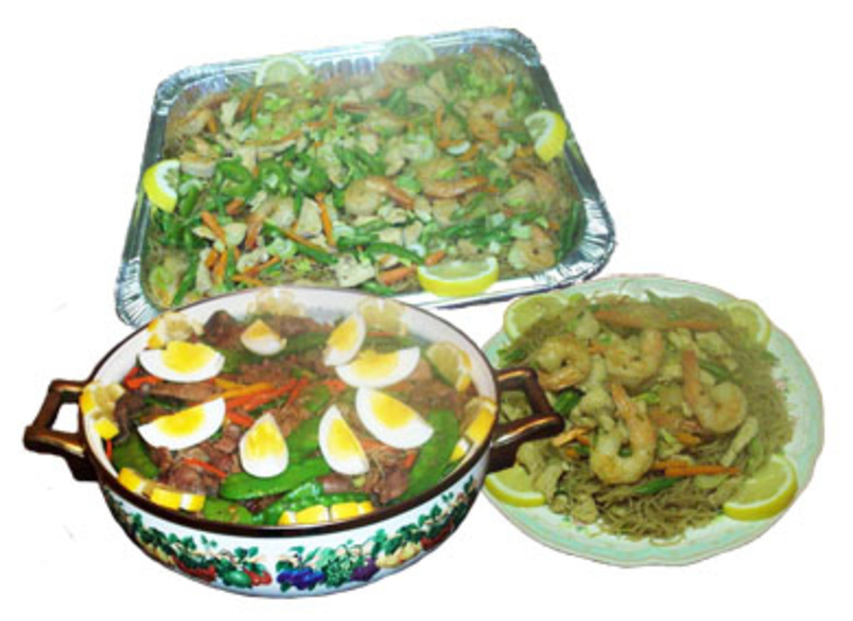 noodles mixed with vegetables and ingredients for special occasions -- pancit bijon and pancit canton