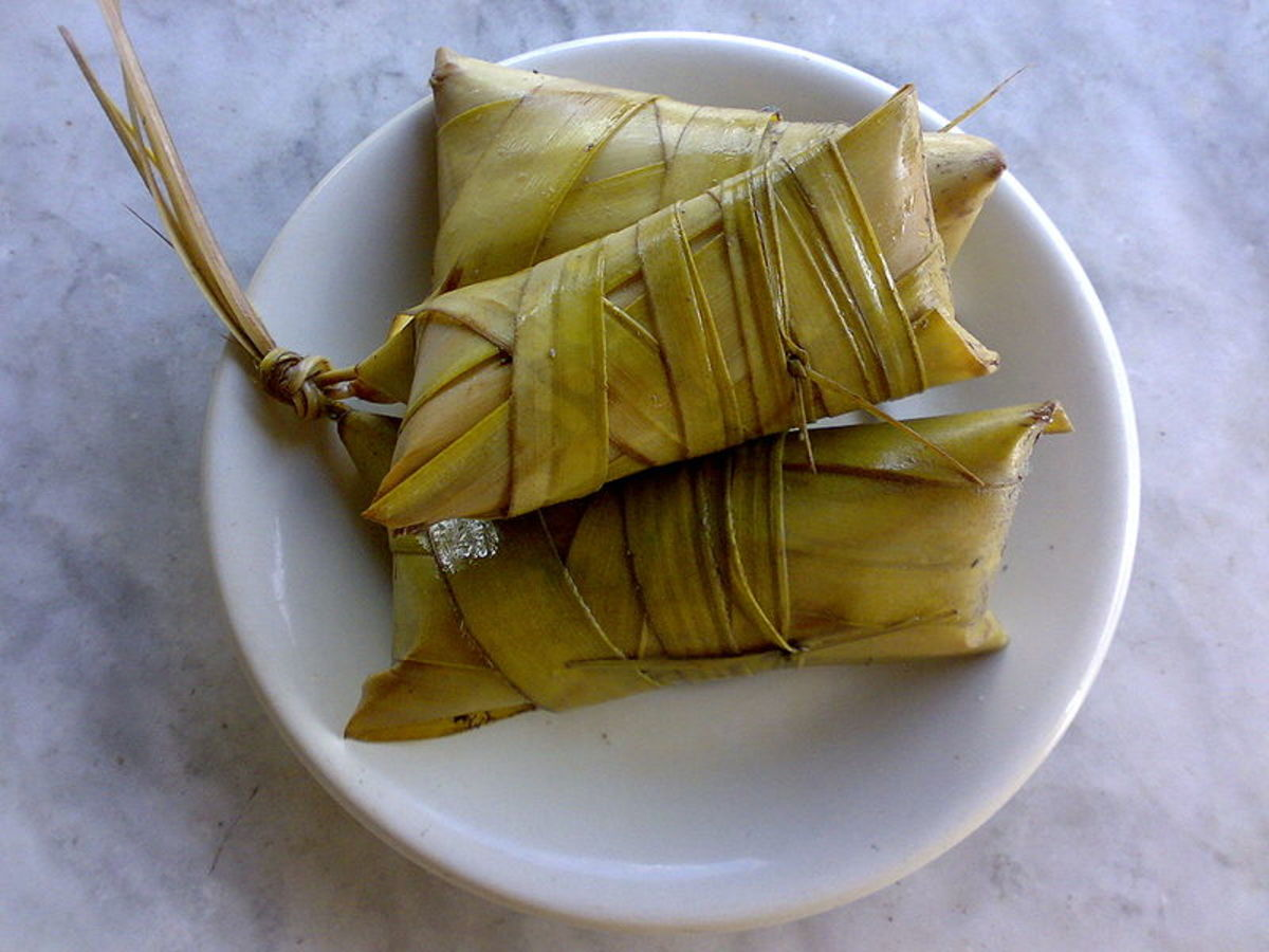 ibos -- a variety of suman -- from rice sticky cooked with sugar and coconut milk covered with coconut leaves