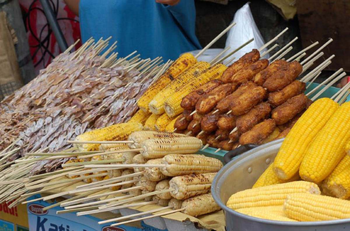 banana cue, corn grilled, and squid are also sold in the streets
