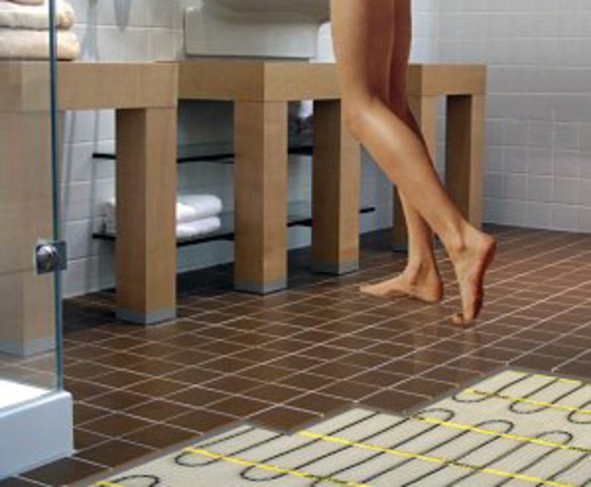 You'll never have to step onto a cold bathroom floor again with electric floor heaters.