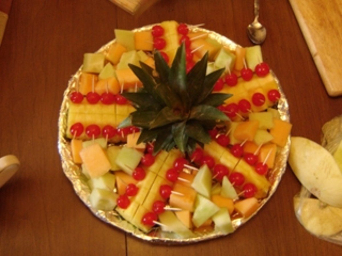 Lay out the pineapple top and the prepared pieces around it.