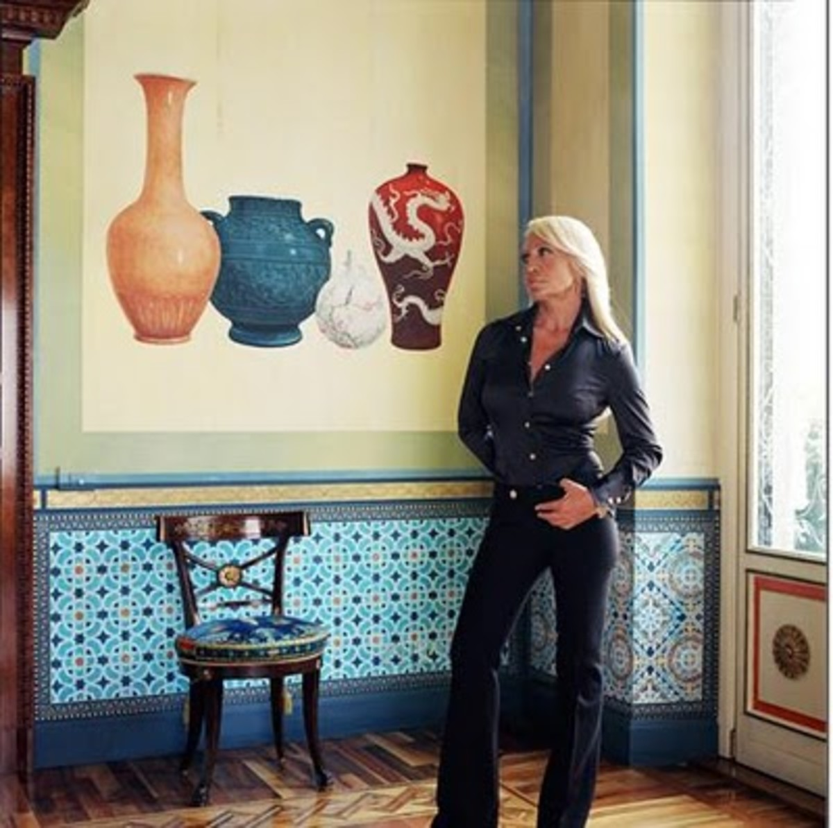 """I'm not a minimalist"" - Donatella Versace, striking a pose in Milan."