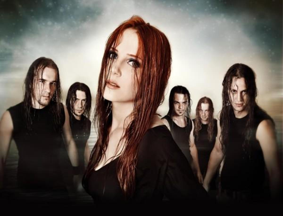 6. Simone Simons of Epica - Now, if you don't know who she is, Google it. The woman is nuts, its hard to find an image without her singing. And her hair