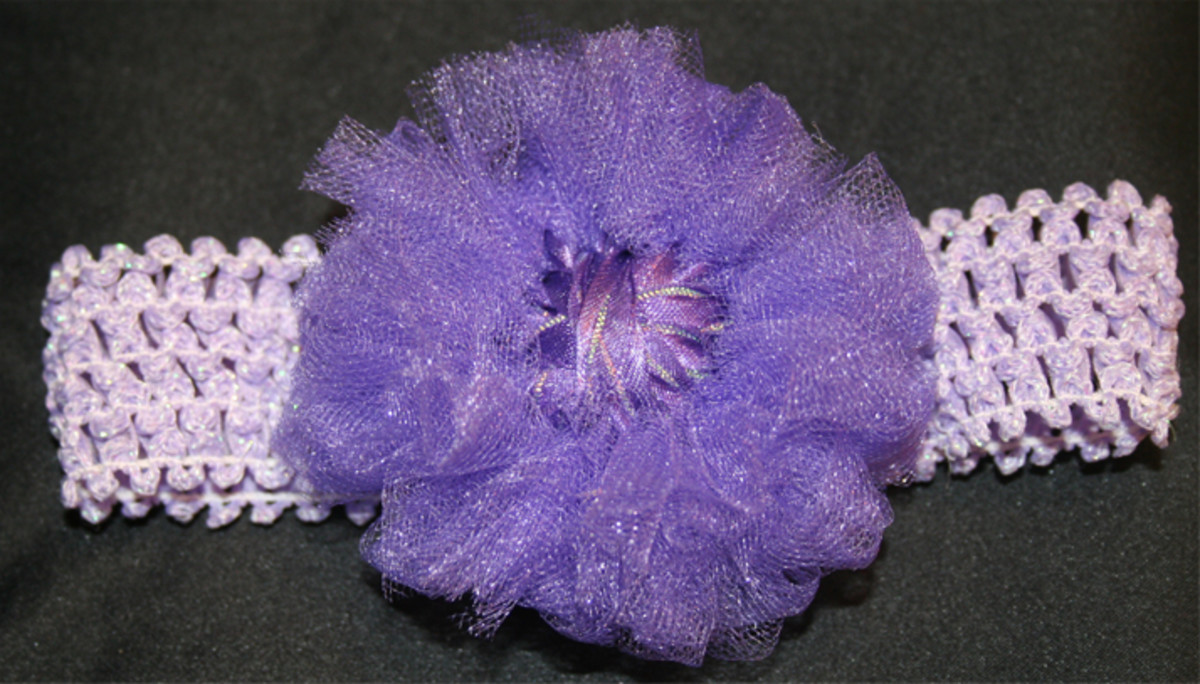 Flower made from purple netting and ribbon on a Knifty Knitter Loom.