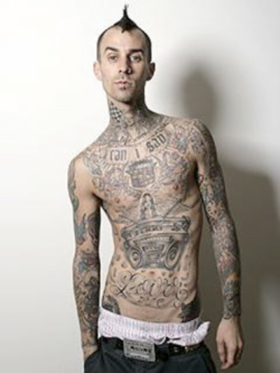 9. Travis Barker of Blink 182 - Though he isn't the lead singer, hes the sexiest drummer Ive ever soon. Saw them live recently, so epic. Hes awesome