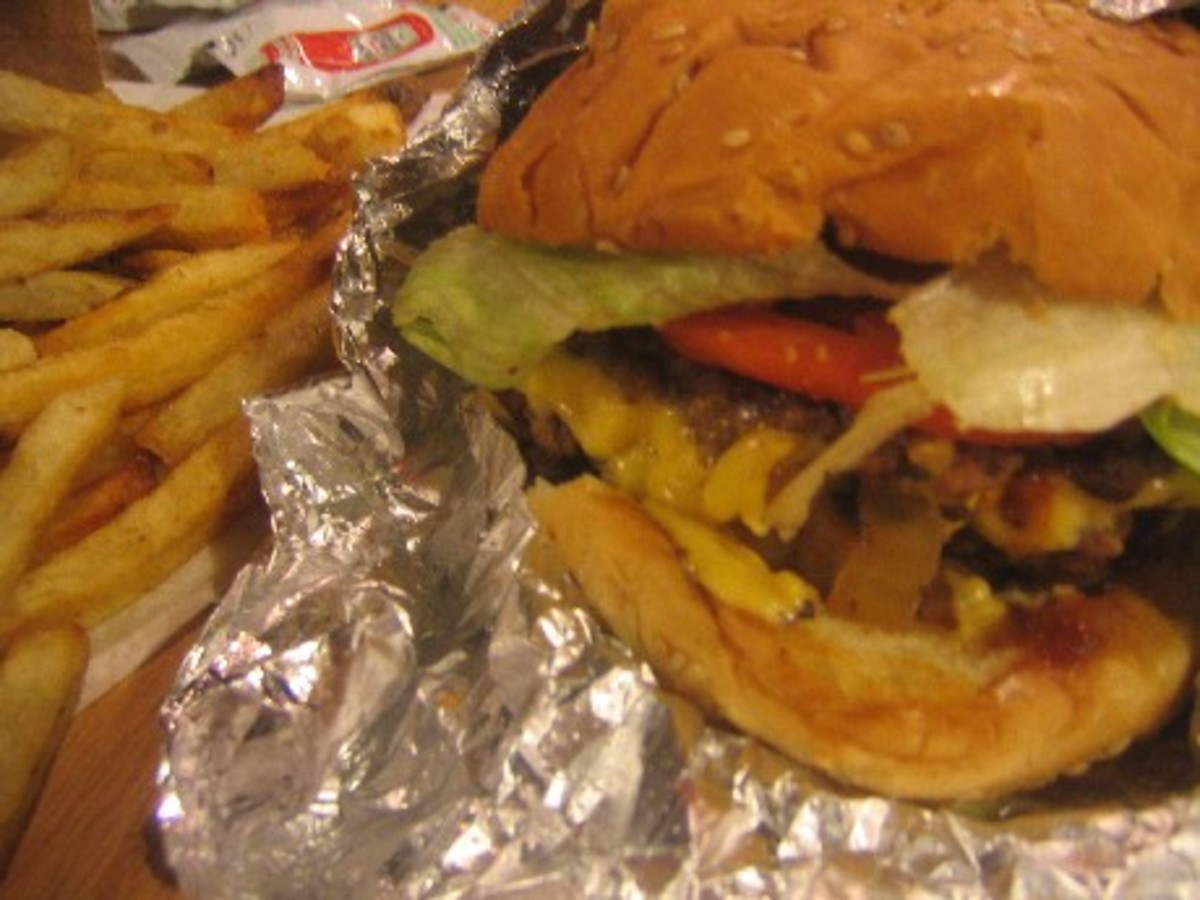 The burger at Five Guys is slightly bigger and comes with any of 14 toppings