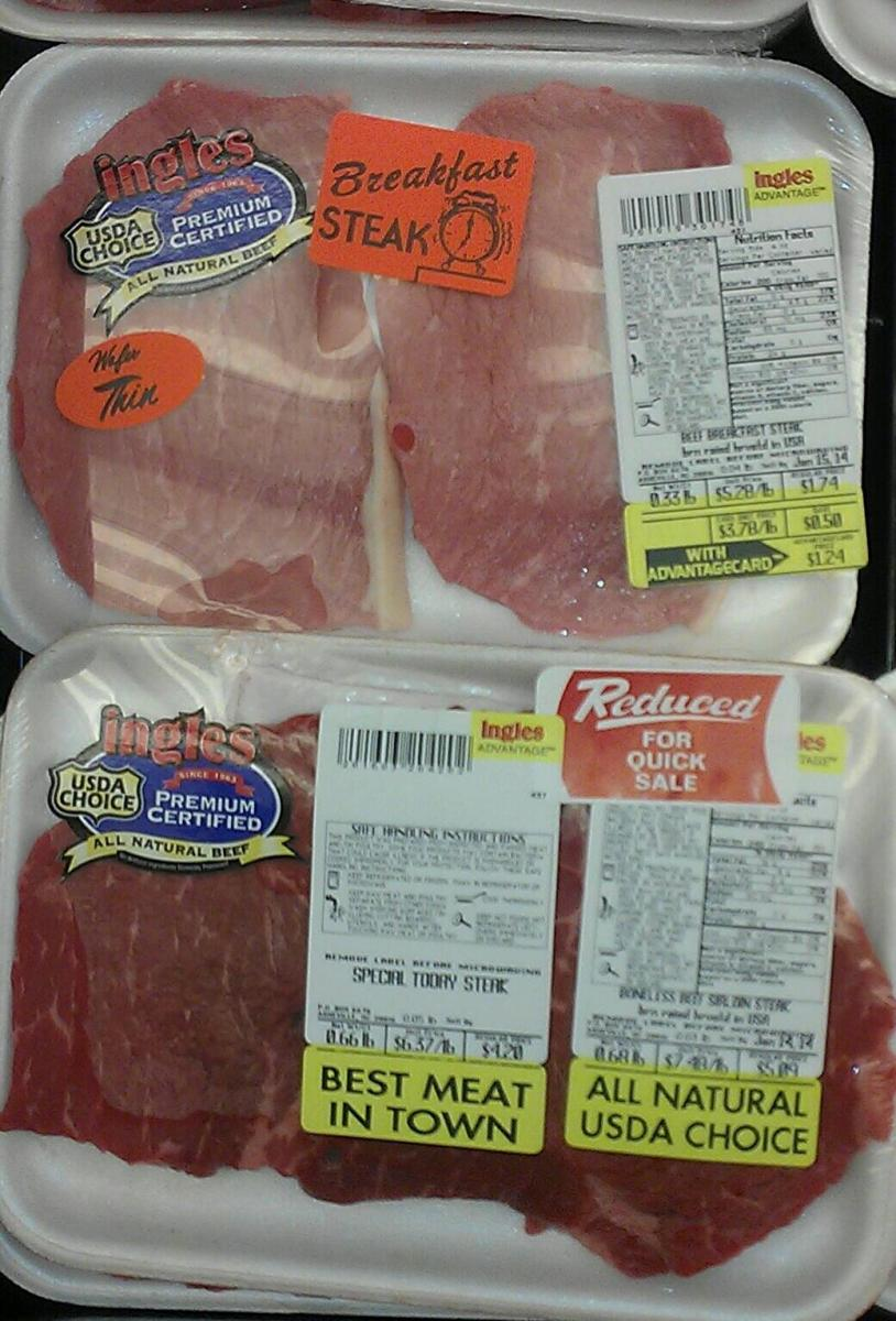 Many times labels or stickers are used to hide flaws or clumps of fat in the meat. You are within your rights as a consumer to open the package and look at the meat. They can always rewrap it in just a few seconds.