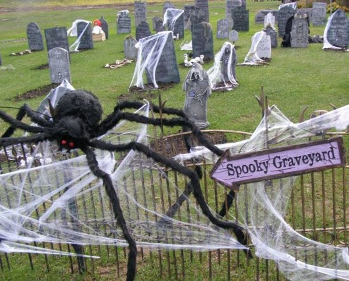 Giant spider in a haunted New York Halloween graveyard, perfect spot for a scavenger hunt.