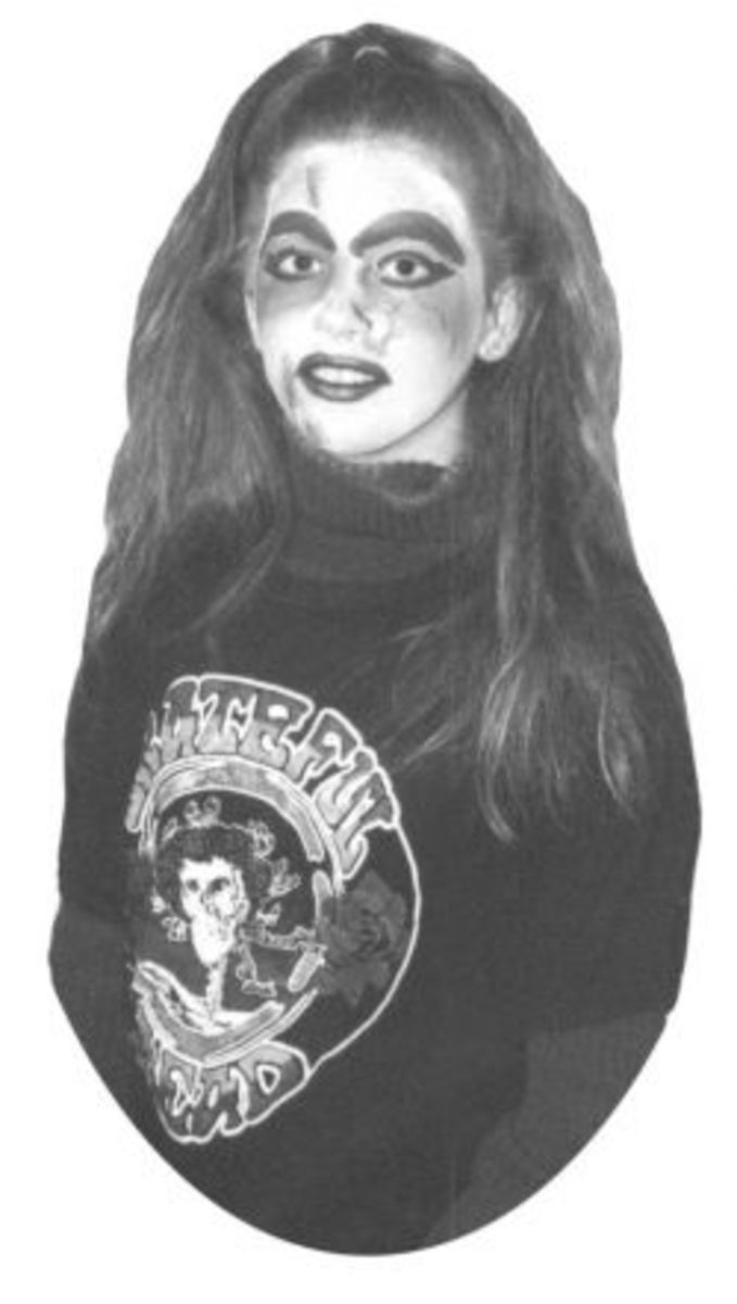 Ghoulish monster makeup on a teen girl, grateful dead zombie costume with home made face paint