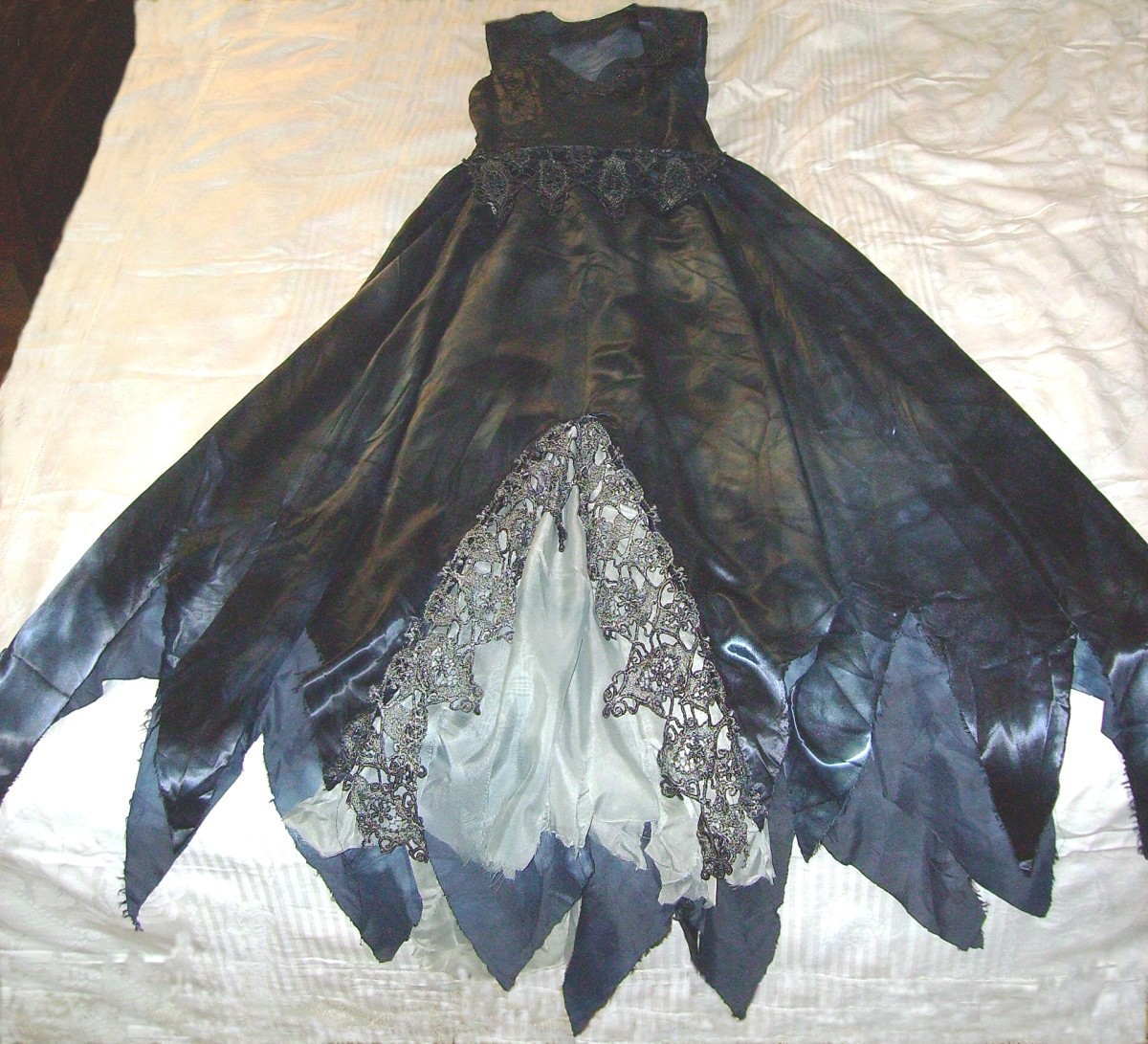 This shows the front bottom of the dress, spread out.