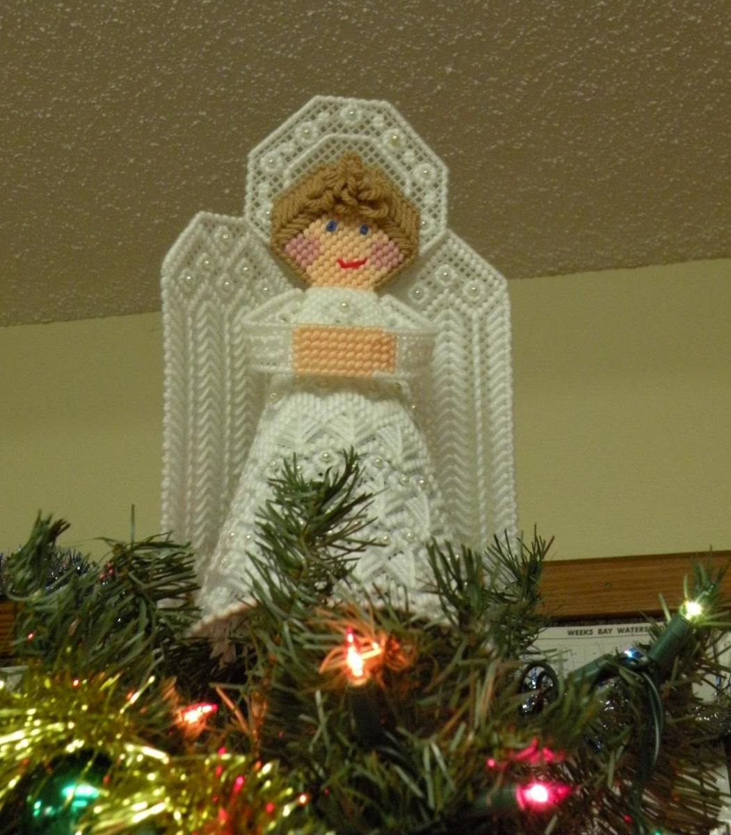 A handcrafted angel tops the tree in the Rainbow Plantation's clubhouse.