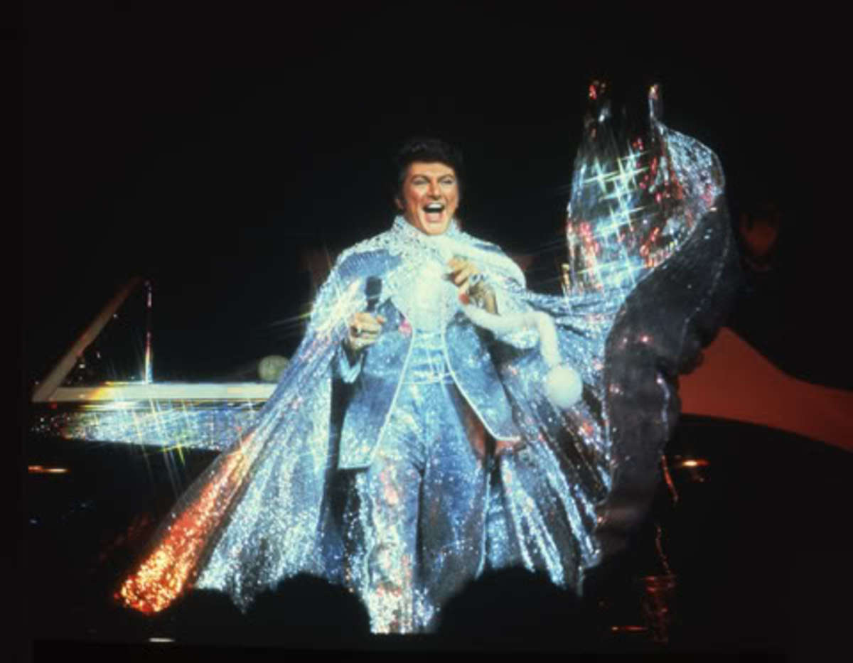 Liberace in costume during one of his concerts.
