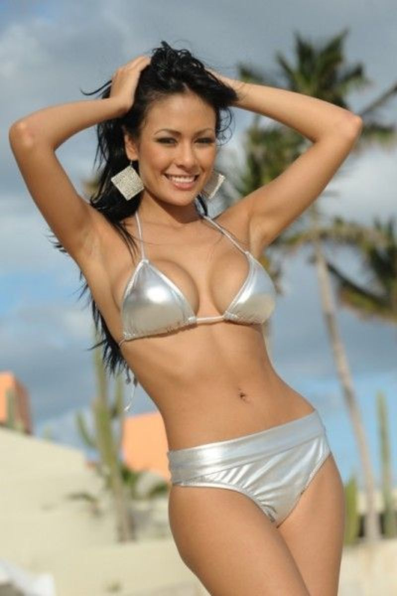 Angies models this Silver metallic two-piece that captures her classic lines and curves fabulously. The bottom has an adjustable band that can be rolled down to reveal more and elongate the waist for that classic look.