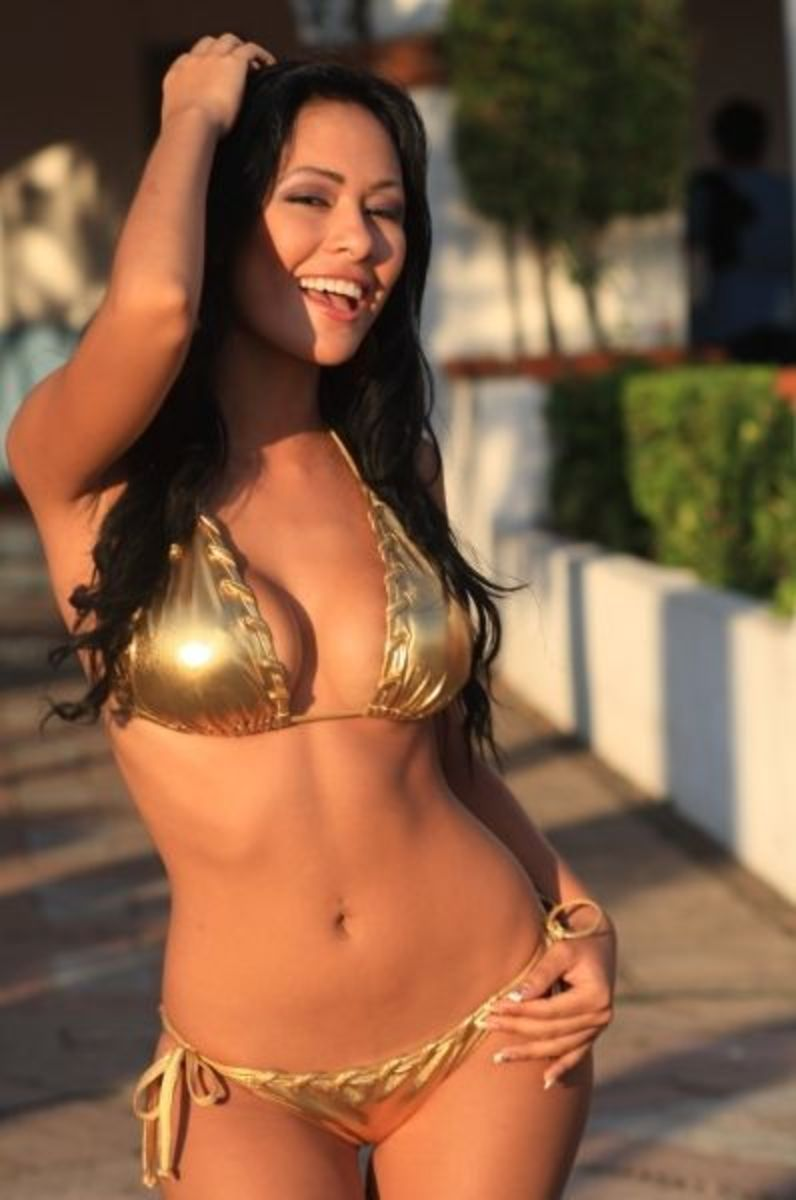 "Piel Dorado!...Angie is the real ""Golden Girl"" and has the bikini to prove it!...vivacious smile illuminates this beautiful models Gold metallic bikini with bold hand-sewn  stitches superbly."