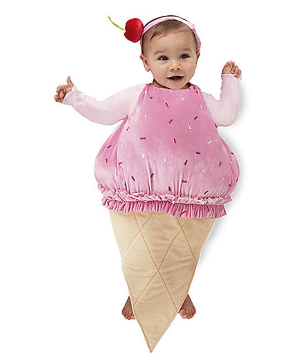 ice cream cone costume on a baby - strawberry on sugar cone