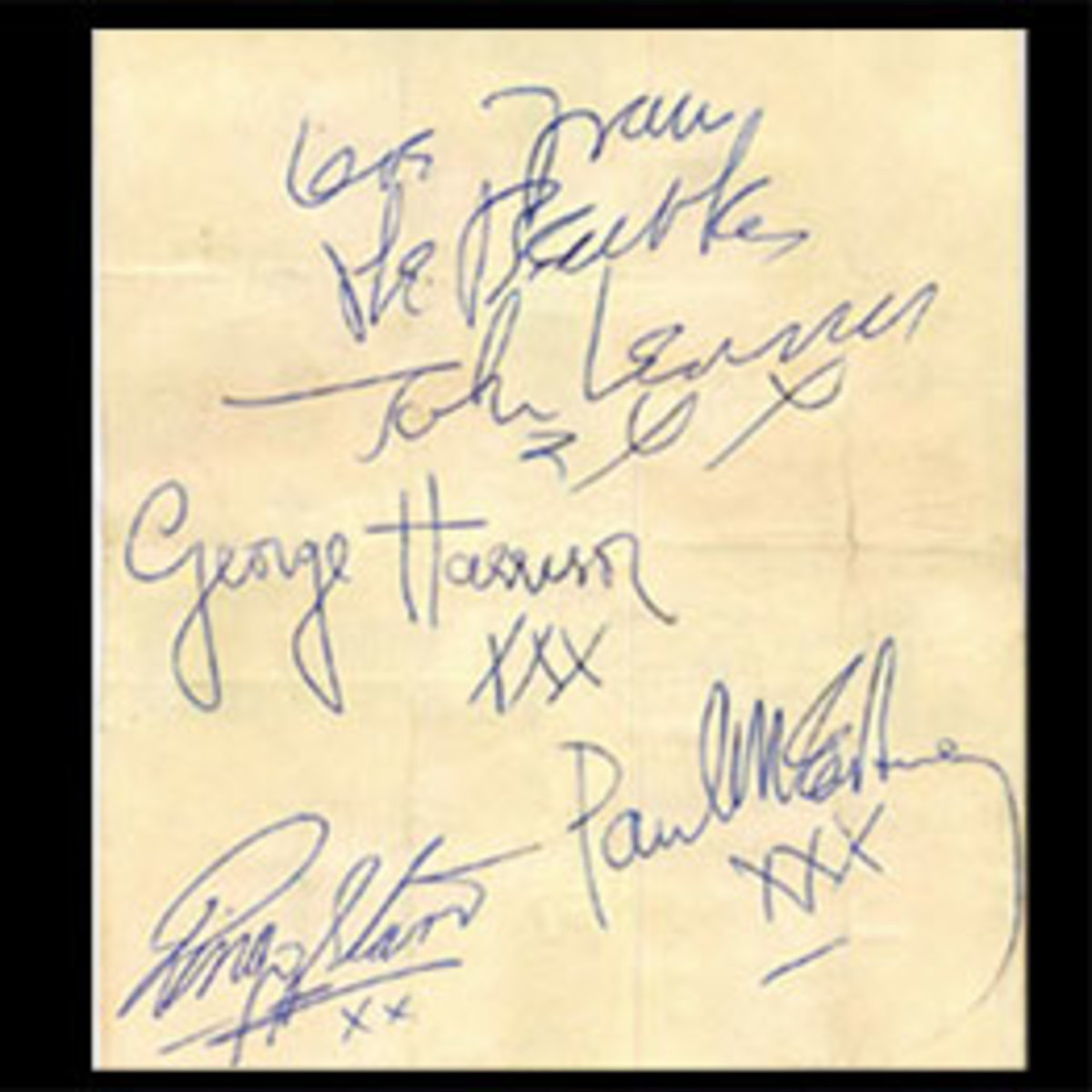 Stained and folded document with all four autographs from the Beatles after restoration