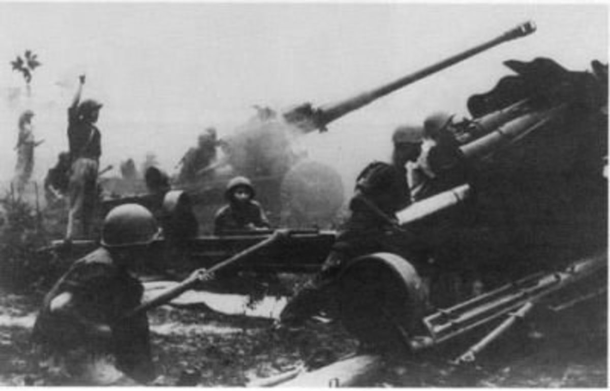 North Vietnamese artillery pounds ARVN positions during the 1972 Easter Offensive. The 130 mm towed field gun had a range of 30 kilometers and played a major role during the offensive.