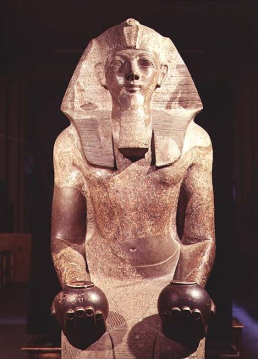 Hatshepsut(Maatkare) is depicted in a fake beard and with objects that a Pharaoh is usually depicted with, and in male attire, after a few years of ruling in female form