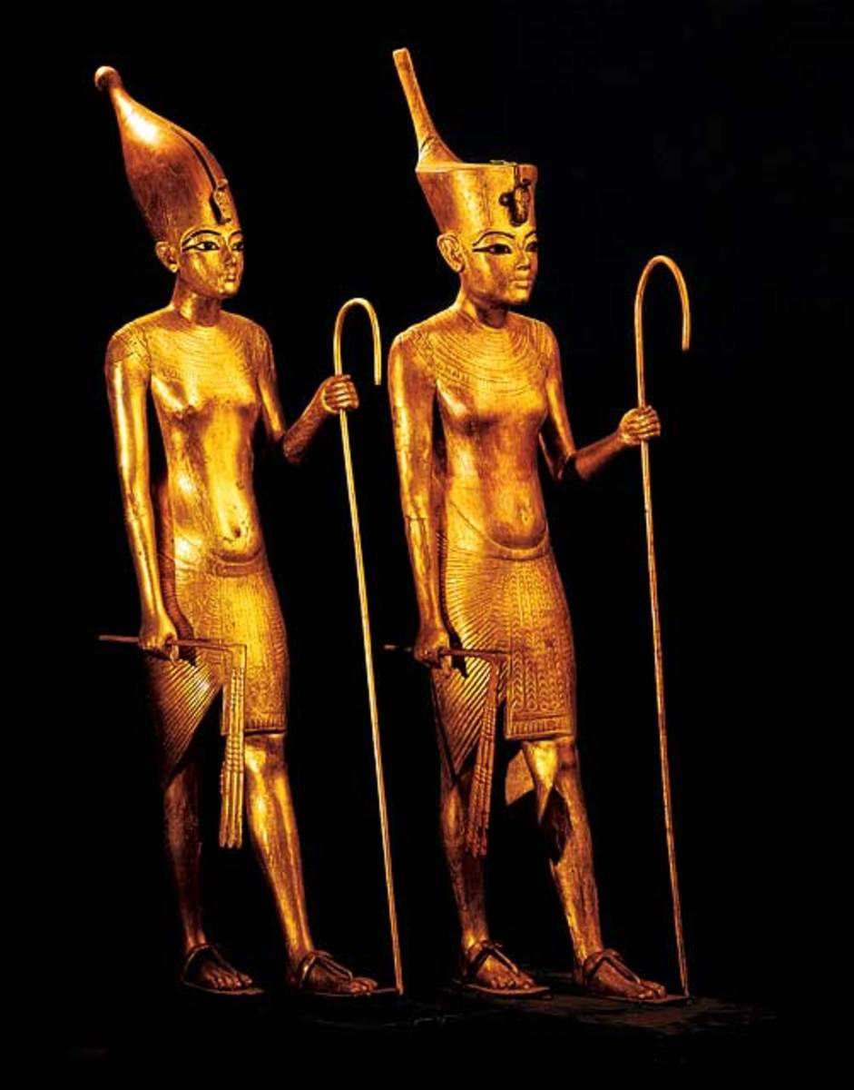 Tutankhamun as king of Upper Egypt(left), Tutankhamun as King of Lower Egypt(Right) - 18th Dynasty, and the statues are made of gilded wood