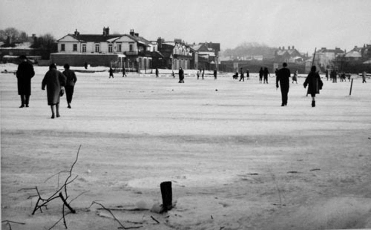 """Residents walking upon the frozen Thames during the """"Great Freeze"""" of 1962-63, January 24, 1963.  Image courtesy Royal Windsor Website.com."""